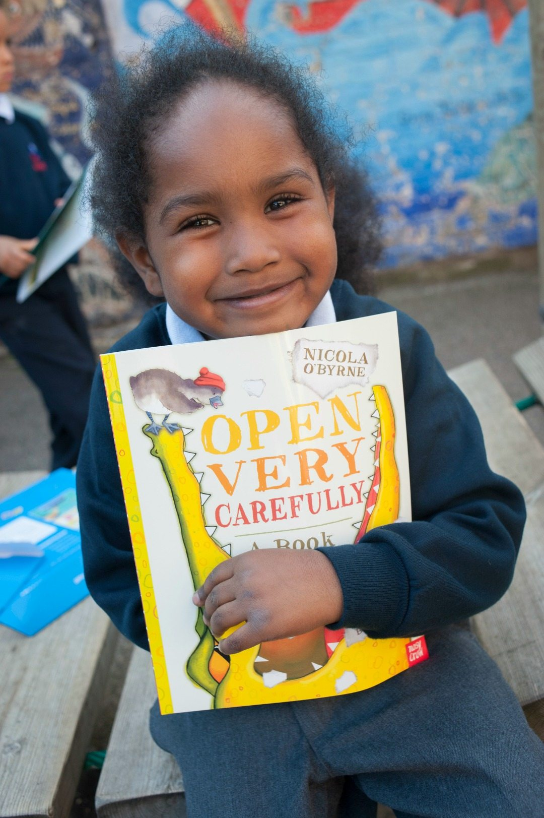 Reading is one of life's amazing pleasures. We've got 15+ back to school books for your kids to explore to make them smile as much as this gorgeous lady!