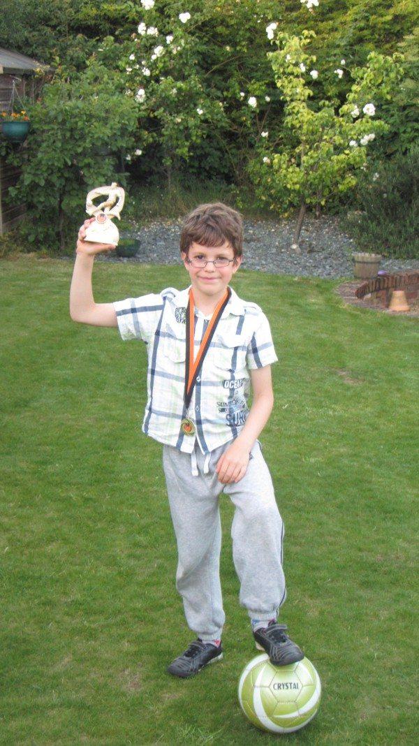 Footballl trophy in the garden - Three cheers!