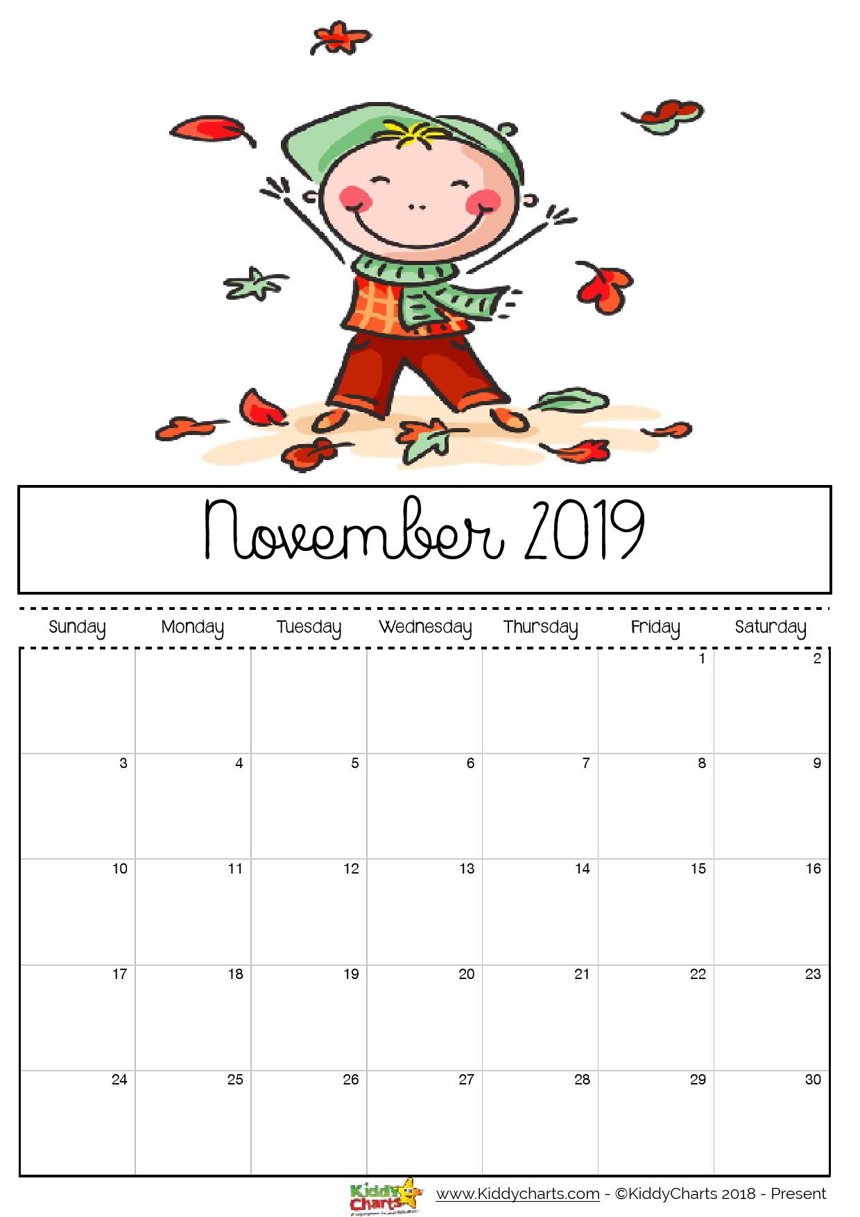 November 2019 printable calendar; boy kicking and playing with leaves - now that looks fun doesn't it?!? #printable #kidsprintables #2019calendar