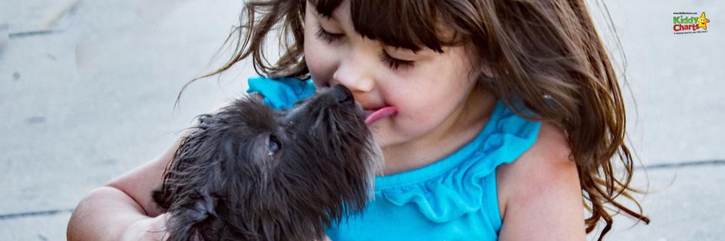 Girl hugging a black dog