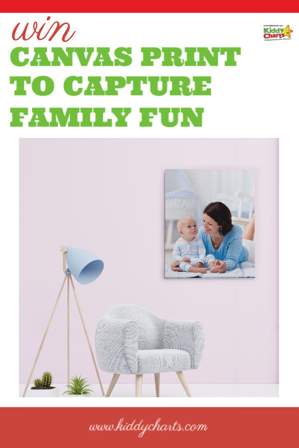 Canvas print in a lounge with a light and a chair showing a mum with her baby.