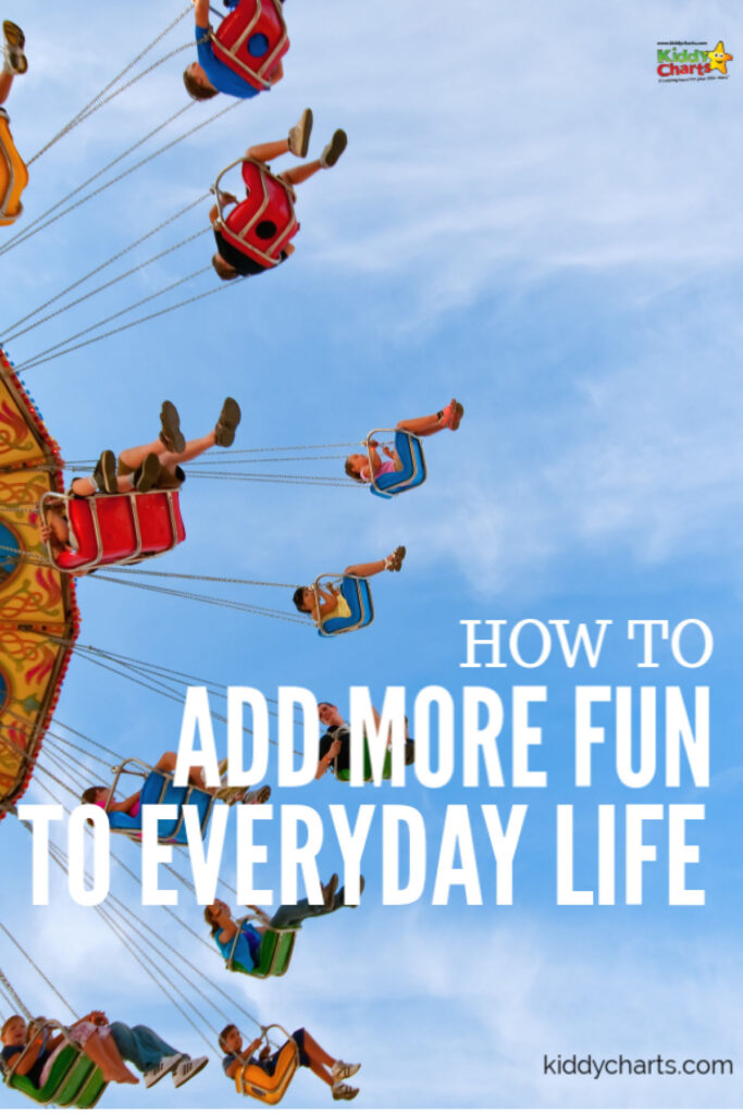 everyday family life: swings at fairground.