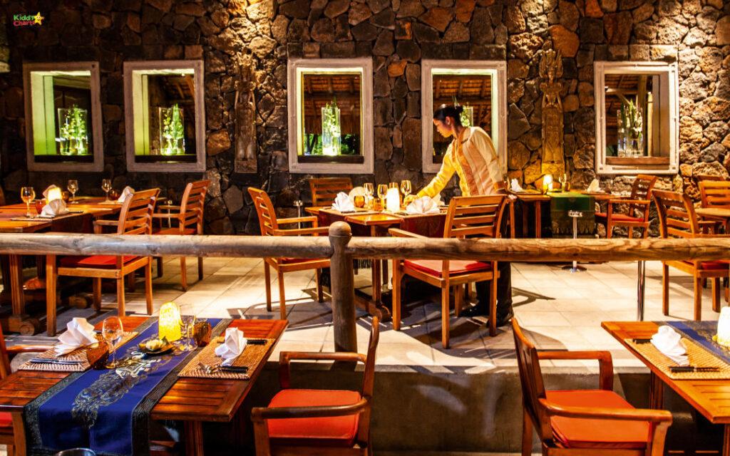 Shandrani resort review: inside of hotel restaurant at night.