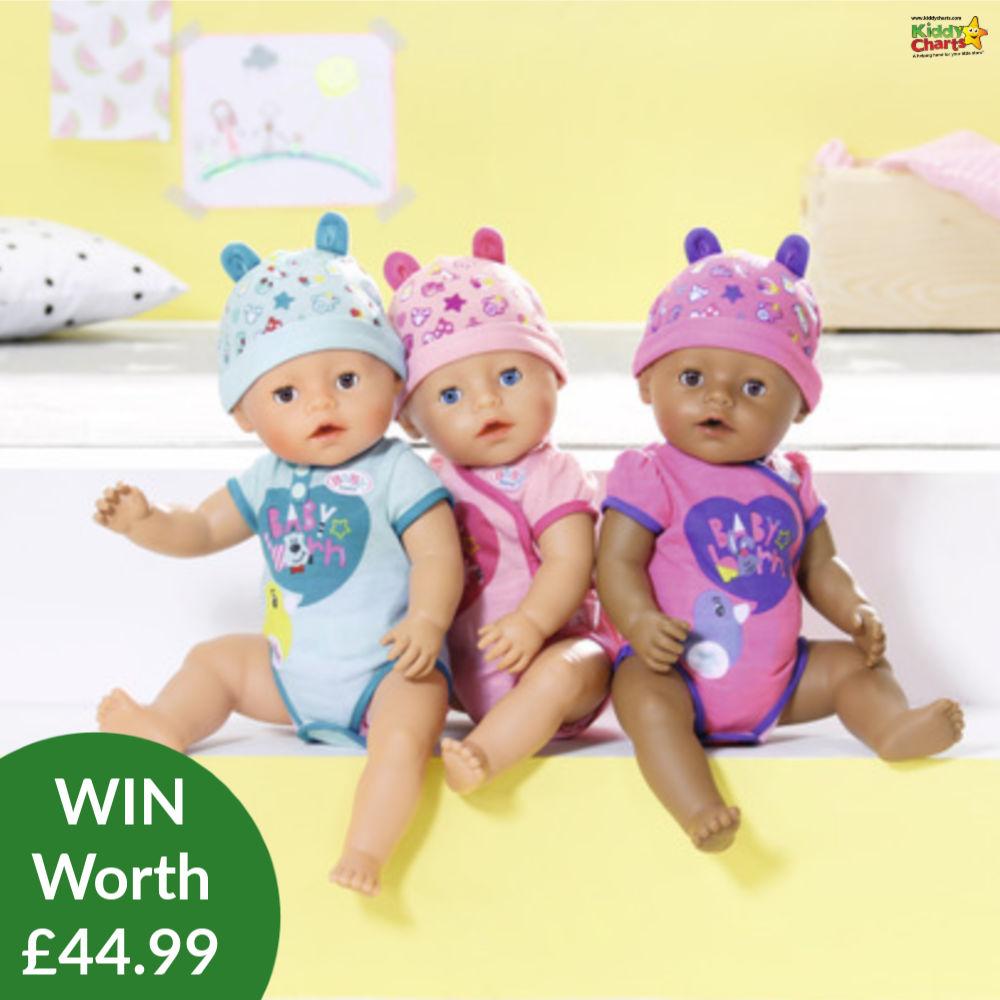 Baby Born Dolls sitting on a shelf - three of them together.
