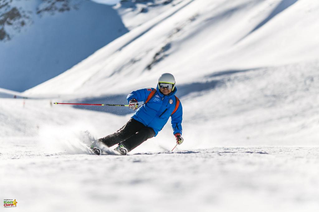 Man ski-ing on slopes.
