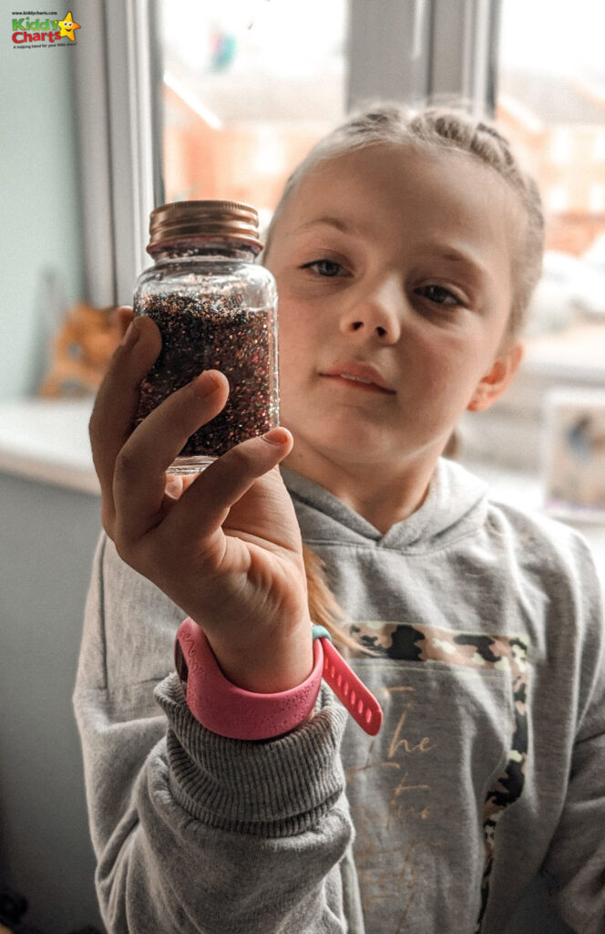 Young girl holding a jar #31DaysOfLearning