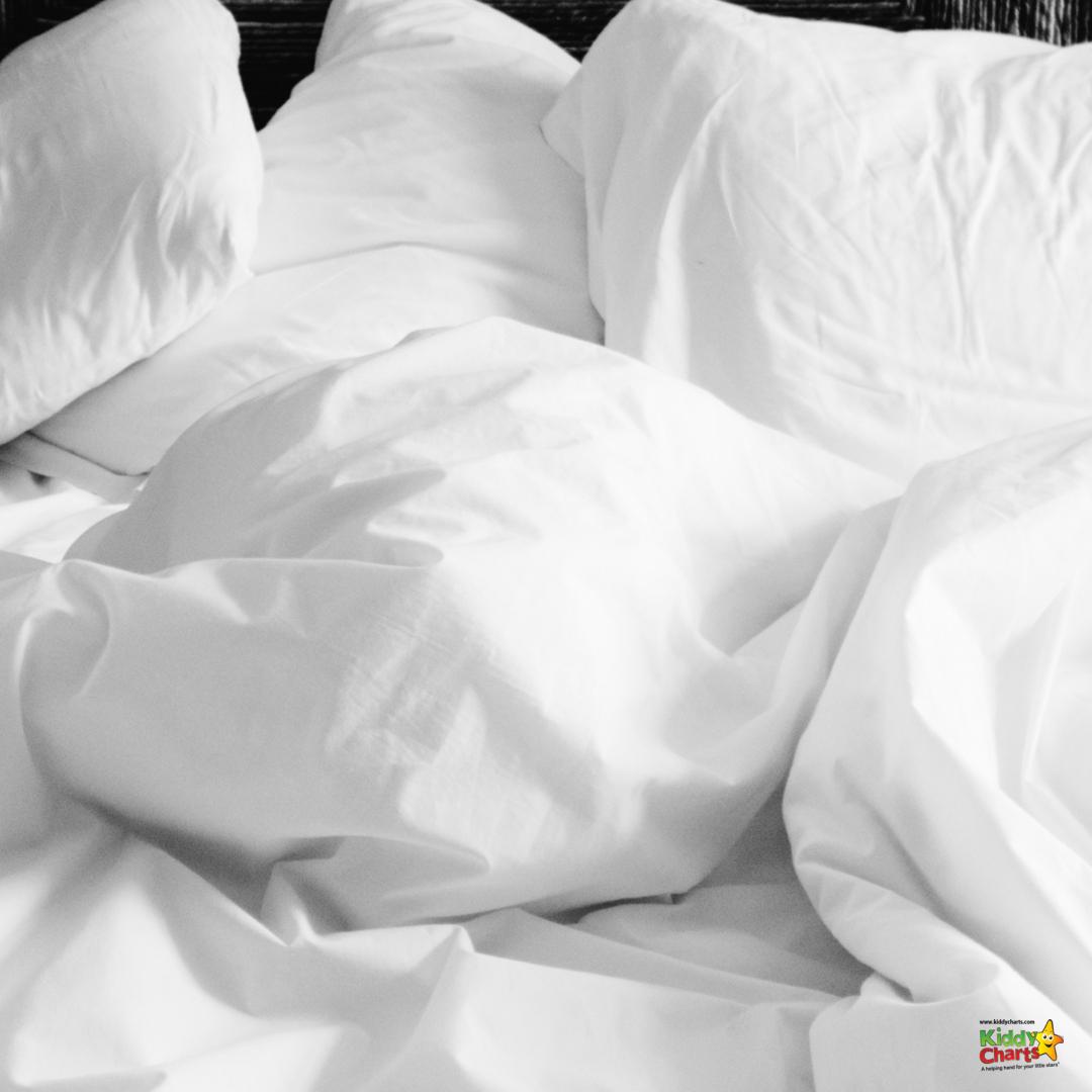 Duvet fort: white duvet on bed.