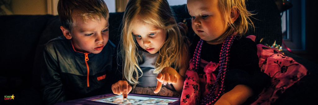 3 children playing with a tablet