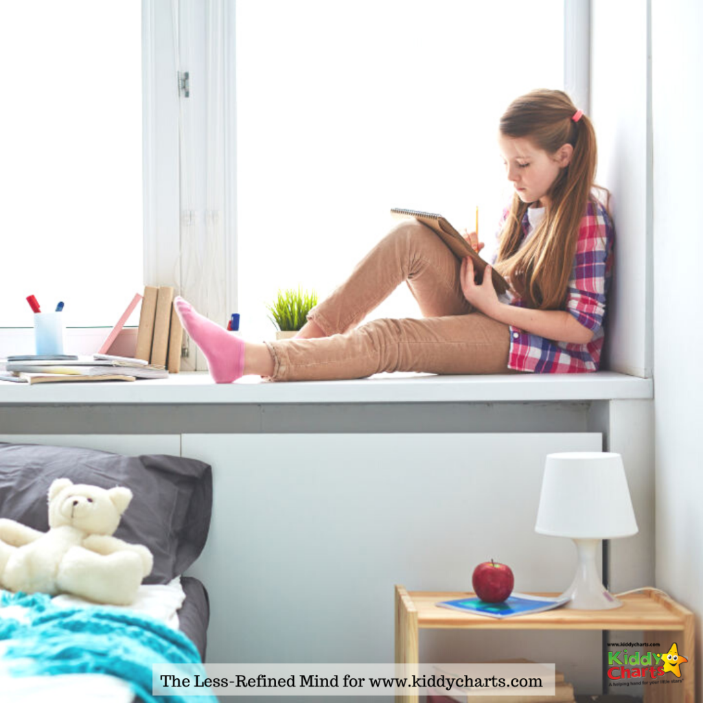 Thoughtful schoolgirl sitting on windowsill alone in her room, writing or drawing in notebook - positive writing prompts