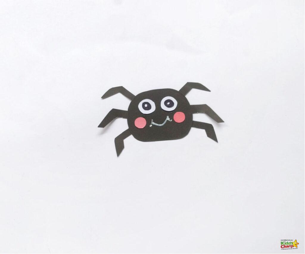 Add the spider's legs