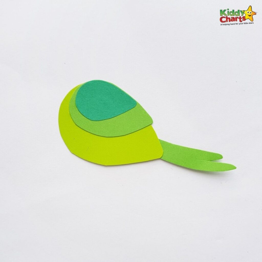 Green parrot paper craft body and tail