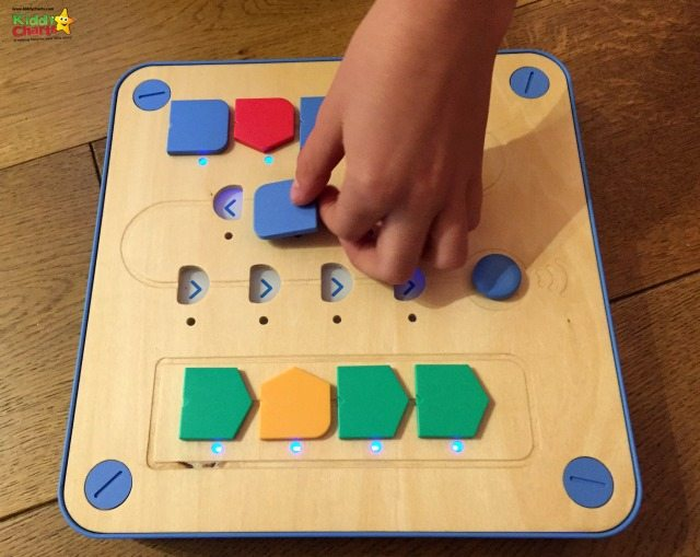 Cubetto teaches coding by enabling you to more the robot using little counters, which represent a program.