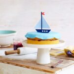 Sail away on a birthday boat cake