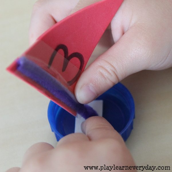 bottle cap sail boats - sticking on sails