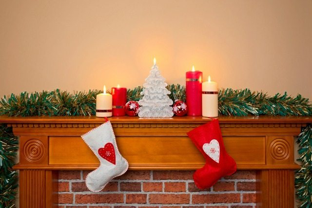 Putting the santa plate on the mantlepiece at Christmas