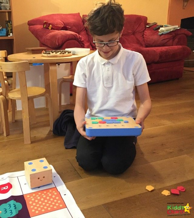 My son explores the possibility of programming Cubetto to tidy up the playroom... ;-)