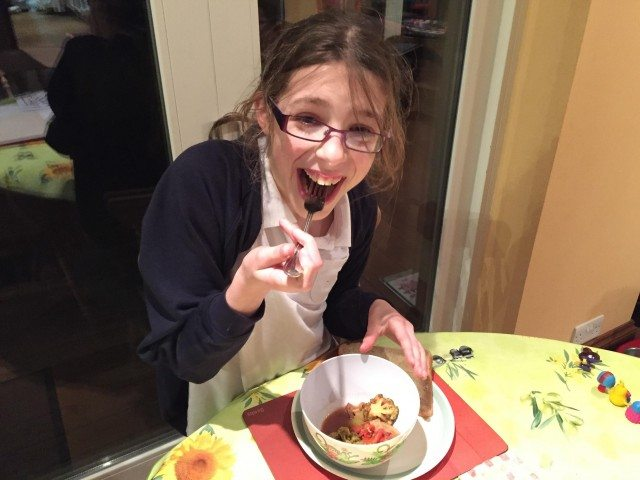 My daiughter enjoying the beef stew quick recip-e - easy to prepare before school, and just as easy to eat!