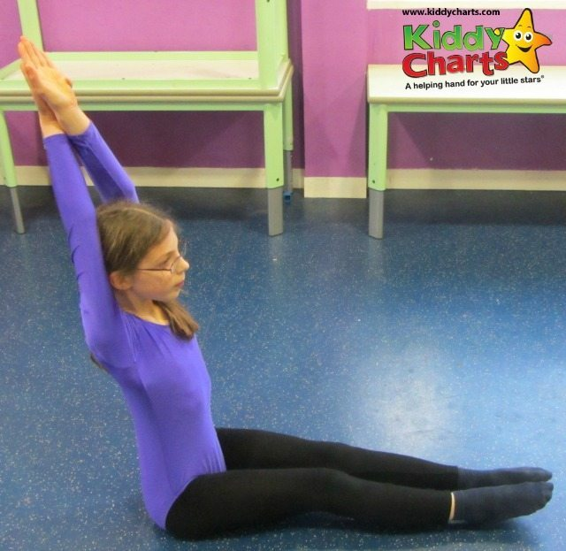 We are hitting some shapes for the head over heels about gymnastics review - this is the long sit, which my daugher is doing rather beautifully if I do say so myself...