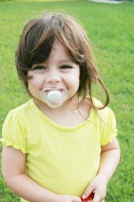 Wean off a dummy: a picture of a baby girl with one
