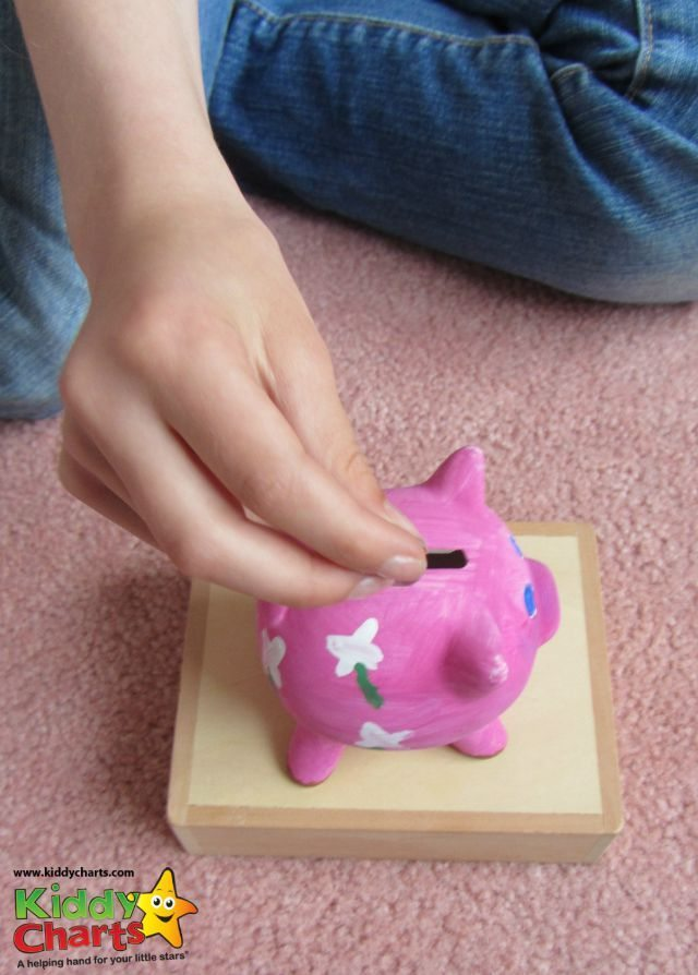 Putting our money in the Jacdo craft kits piggy bank :-D