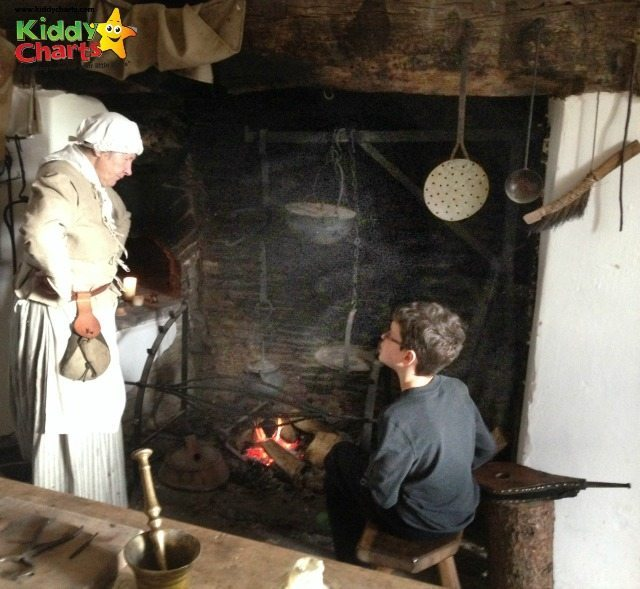 Llancaiach Fawr gives the kids a chance to try what kids would have done in 1645 - here is Stuntboy as a spit boy!