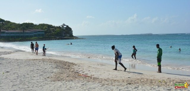 Playing cricket with the locals in Long Bay near the Verandah Resort and Spa
