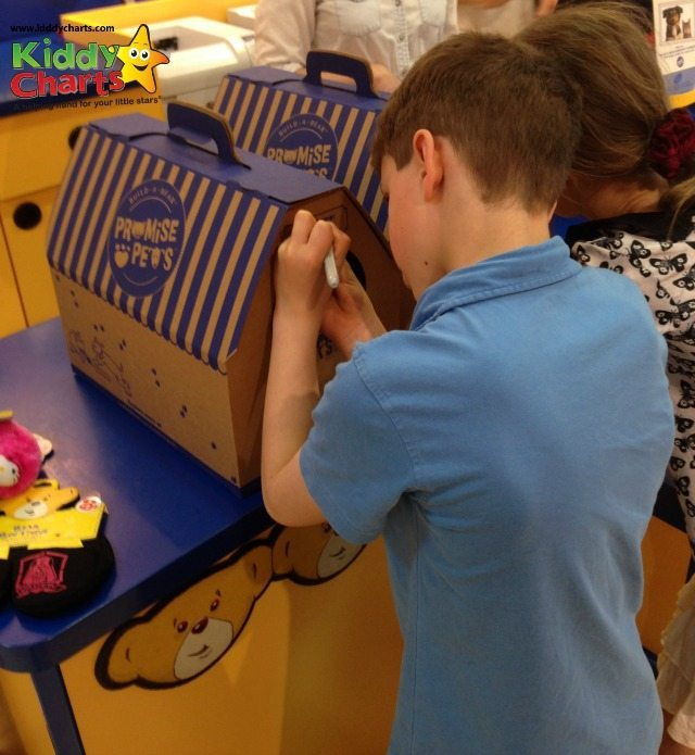 Promise Pets even come with their own kennels - here is my son writing his dogs name on the front of his kennel....