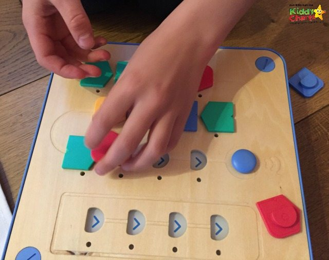 Cubetto just needs you to add the blocks for the programs in the right order, and press the blue start button - and he's off!