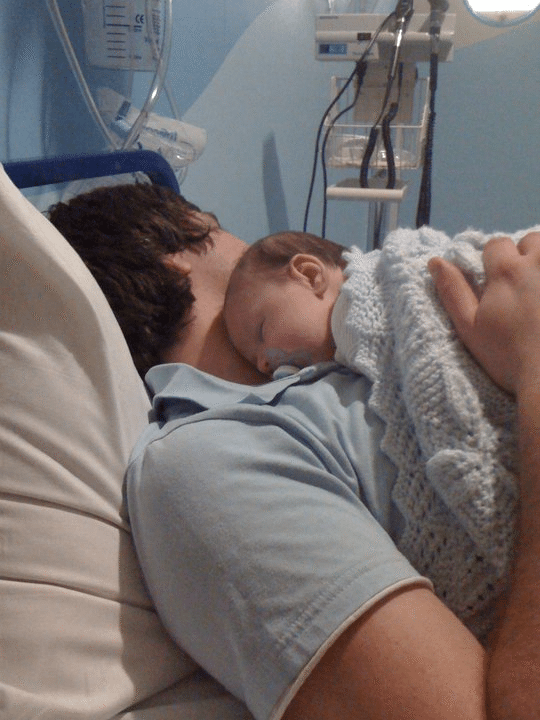 Silent reflux in babies: Eli happy asleep on daddy