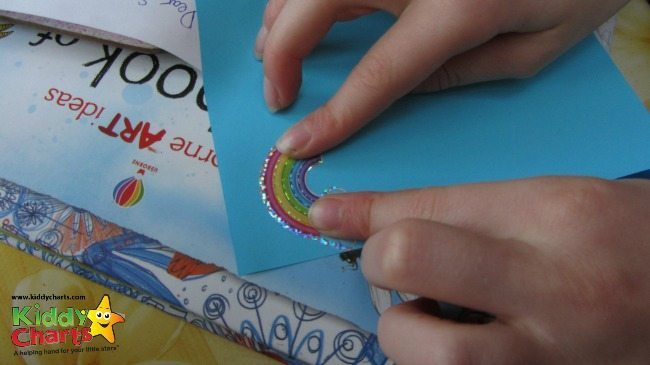 Sticking to our Pipsticks Sticker Club paper - making our magic land!